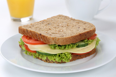 lettuce: Sandwich toast bread for breakfast with cheese and orange juice, tomatoes, lettuce Stock Photo