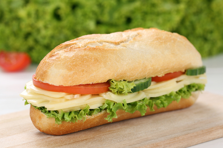 deli sandwich: Sub deli sandwich baguette with cheese, tomatoes and lettuce