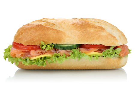 Sub deli sandwich baguette with salmon fish, cheese, tomatoes and lettuce side view isolated on a white background