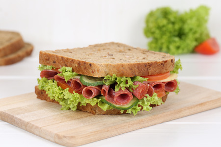 eating pastry: Sandwich toast bread for breakfast with salami, cheese, tomatoes, lettuce Stock Photo