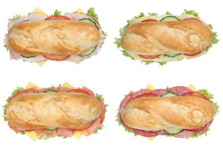 bocadillo: Colecci�n de sub sandwiches barras de pan con salami, jam�n y queso vista desde arriba aislados en un fondo blanco