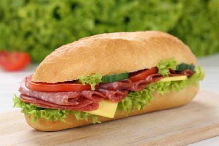 deli sandwich: Sub deli sandwich baguette with salami, cheese, tomatoes and lettuce Stock Photo