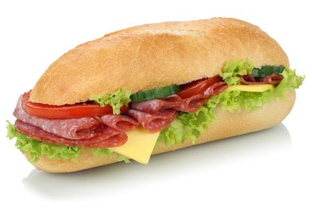 Sub deli sandwich baguette with salami, cheese, tomatoes and lettuce isolated on a white background