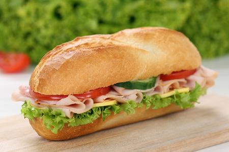 deli sandwich: Sub deli sandwich baguette with ham, cheese, tomatoes and lettuce