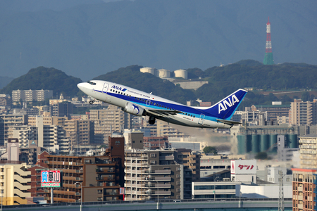 airways: Fukuoka, Japan - October 13, 2015: A ANA All Nippon Airways Boeing 737-500 with the registration JA302K takes off from Fukuoka Airport (FUK) in Japan. ANA is the largest airline in Japan with its headquarters in Tokyo. Editorial