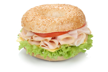 Bagel sandwich for breakfast with ham, cream cheese, tomatoes and lettuce isolated on a white background Foto de archivo