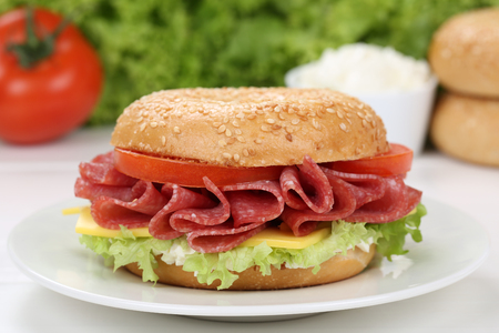 cream cheese: Bagel for breakfast with salami ham, cream cheese, tomatoes and lettuce