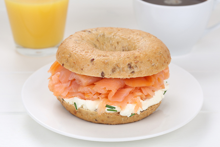 orange juice: Bagel sandwich for breakfast with salmon fish, cream cheese, orange juice and coffee Stock Photo
