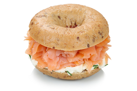 Bagel sandwich for breakfast with salmon fish isolated on a white background