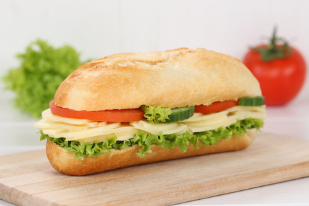 deli sandwich: Sub deli sandwich baguette with cheese, tomatoes and lettuce for breakfast