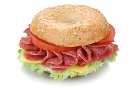 white cheese: Bagel sandwich for breakfast with salami ham, cream cheese, tomatoes and lettuce isolated on a white background Stock Photo