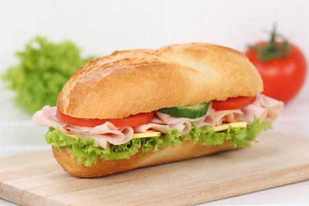 deli sandwich: Sub deli sandwich baguette with ham, cheese, tomatoes and lettuce for breakfast