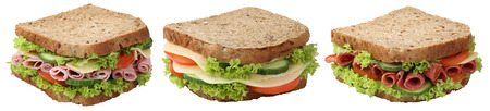 Collection of sandwiches toasts breads for breakfast with salami ham cheese, tomatoes, lettuce isolated on a white background