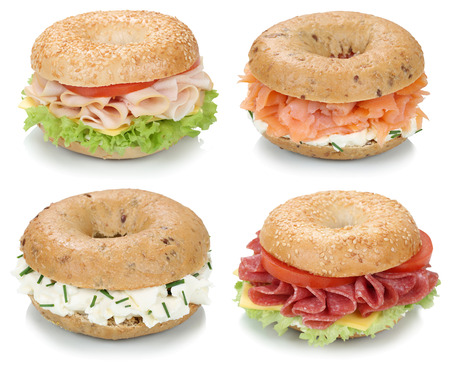 ham: Collection of bagels with cream cheese, salmon, salami, tomatoes and ham for breakfast isolated on a white background