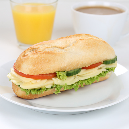 deli sandwich: Healthy eating sub deli sandwich baguette for breakfast with cheese, tomatoes, lettuce and orange juice