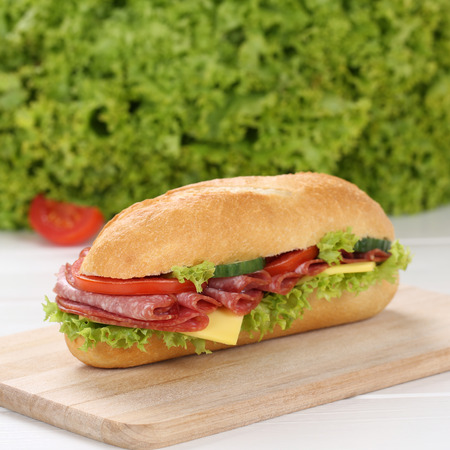 deli sandwich: Healthy eating sub deli sandwich baguette with salami, cheese, tomatoes and lettuce Stock Photo
