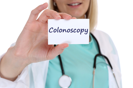 colonoscopy: Colonoscopy cancer prevention screening check-up disease ill illness nurse doctor with sign Stock Photo