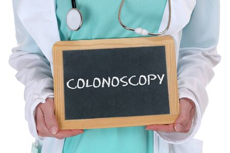 colonoscopy: Colonoscopy cancer prevention screening check-up disease ill illness doctor with sign