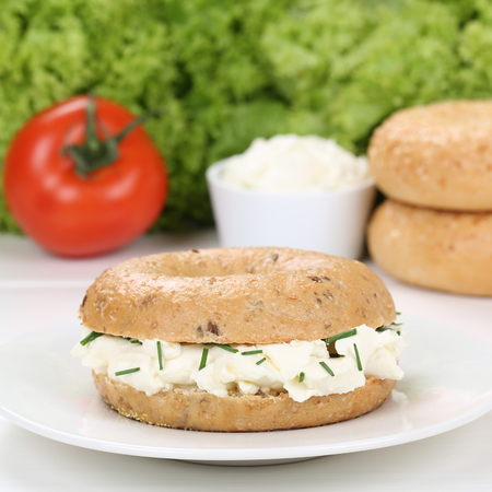 cream cheese: Healthy eating bagel with cream cheese and parsley for breakfast
