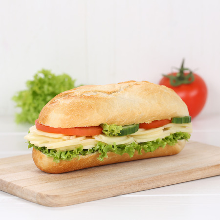 deli sandwich: Healthy eating sub deli sandwich baguette with cheese, tomatoes and lettuce for breakfast Stock Photo