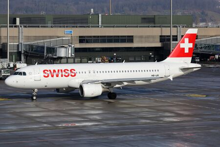 Zurich, Switzerland - January 23, 2016: A Swiss International Air Lines Airbus A320 with the registration HB-IJX taxis at Zurich Airport (ZRH) in Switzerland. Swiss is the flag carrier airline of Switzerland with its headquarters in Zurich.