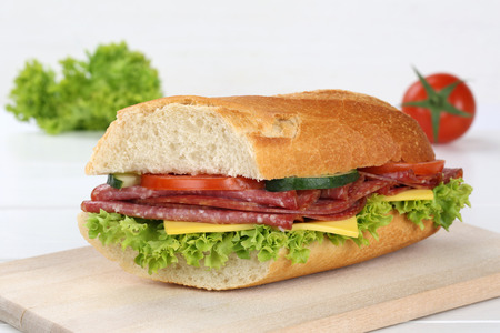sub sandwich: Sub sandwich baguette with salami ham, cheese, tomatoes and lettuce Stock Photo