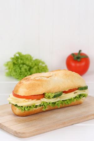 deli sandwich: Sub deli sandwich baguette with cheese, tomatoes and lettuce  copy space Stock Photo