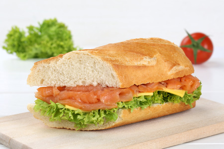 sub sandwich: Sub sandwich baguette with salmon fish, cheese, tomatoes and lettuce