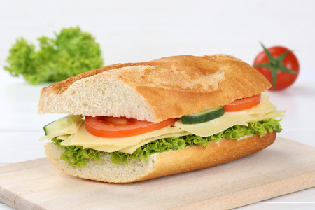 sub sandwich: Sub sandwich baguette with cheese, tomatoes and lettuce Stock Photo