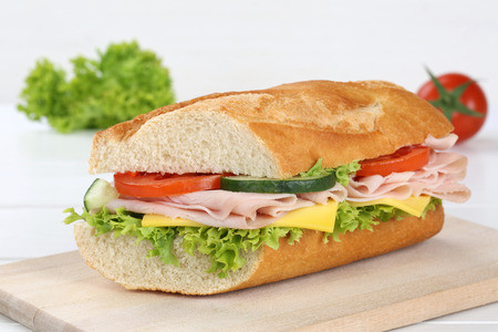 Sub sandwich baguette with ham, cheese, tomatoes and lettuce