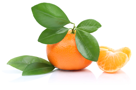 sliced: Mandarin orange tangerine slices with leaves isolated on a white background