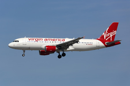 lax: Los Angeles, USA - February 19, 2016: A Virgin America Airbus A320 with the registration N840VA landing at Los Angeles International Airport (LAX) in the USA. Virgin America is a low-cost carrier headquartered in San Francisco.