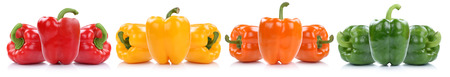 bell peppers: Collection of bell pepper peppers paprika paprikas in a row isolated on a white background Stock Photo
