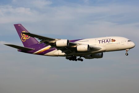 airways: Tokyo, Japan - October 9, 2015: A Thai Airways Airbus A380-800 with the registration HS-TUF landing at Tokyo Narita International Airport (NRT) in Japan. The Airbus A380 is the worlds largest passenger airliner. Thai Airways is the flag carrier airline o Editorial