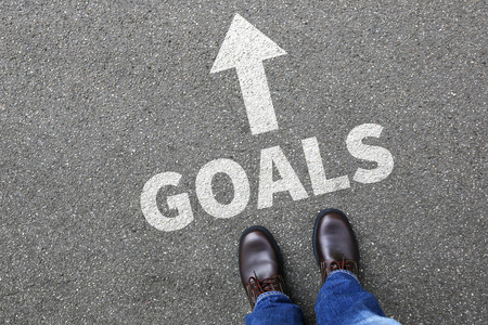 Goal goals to success aspirations and growth targets businessman business man concept