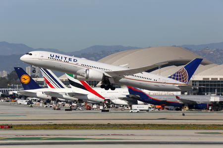 american airlines: Los Angeles, USA - February 22, 2016: A United Airlines Boeing 787-9 with the registration N13954 takes off from Los Angeles International Airport (LAX) in the USA. United Airlines is an American airline headquartered in Chicago.