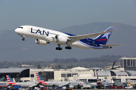 lax: Los Angeles, USA - February 22, 2016: A LAN Airlines Boeing 787-8 with the registration CC-BBI takes off from Los Angeles International Airport (LAX) in the USA. LAN Airlines is the flag carrier airline of Chile.