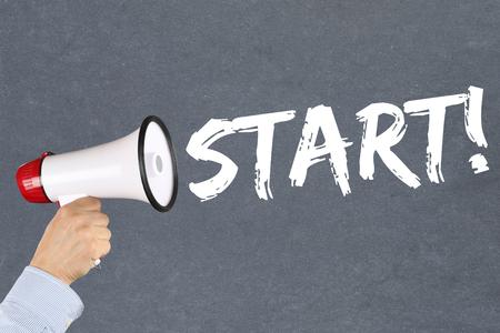 sports race: Start starting running race sport sports hand with megaphone Stock Photo