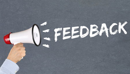 respond: Feedback contact customer service opinion survey business concept review hand with megaphone Stock Photo