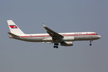 north korea: Beijing, China - May 21, 2016: An Air Koryo Tupolev Tu-204 airplane with the registration P-633 approaches Beijing International Airport (PEK) in China. Air Koryo is the flag carrier airline of North Korea based in Pyongyang.