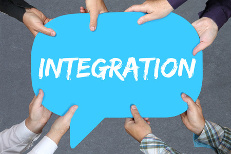 immigrants: Group of people holding with hands the word integration immigrants refugees immigrant refugee Stock Photo