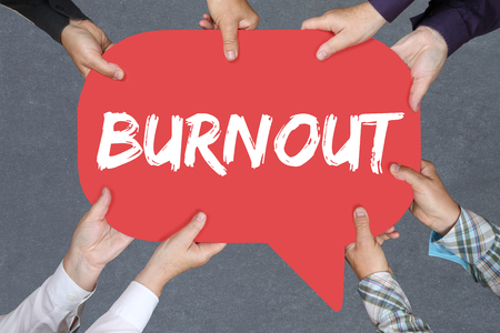 destress: Group of people holding with hands the word burnout ill illness stress stressed at work business concept Stock Photo