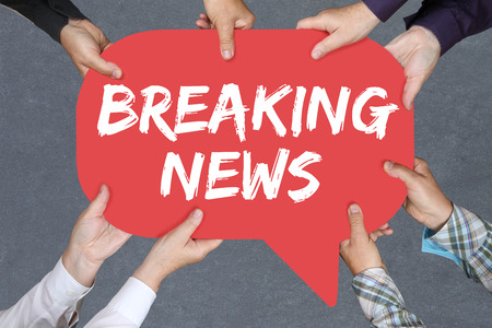 Group of people holding with hands the word Breaking news media announcement announce information Stock Photo