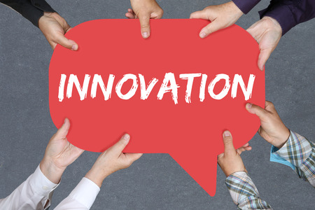 winning idea: Group of people holding with hands the word innovation idea leadership success successful winning business concept innovate creativity Stock Photo