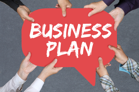 group strategy: Group of people holding with hands the word business plan analysis strategy success company Stock Photo