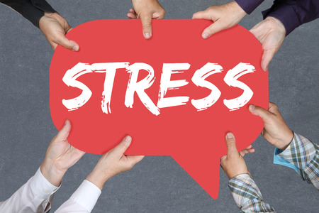 destress: Group of people holding with hands the word stress stressed business concept burnout at work relaxed
