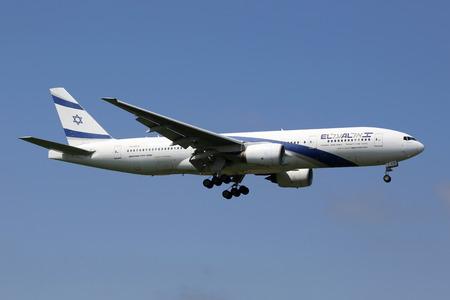 plane landing: London Heathrow, United Kingdom - May 13, 2016: An El Al Boeing 777-200 with the registration 4X-ECB landing at London Heathrow Airport (LHR) in the United Kingdom. El Al is the flag carrier airline of Israel.