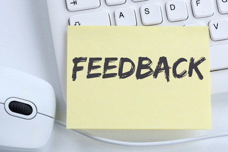 business contact: Feedback contact customer service opinion survey business concept review office computer keyboard Stock Photo