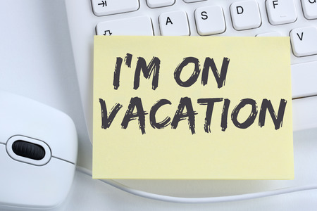 free time: Im on vacation travel traveling holiday holidays relax relaxed break free time office computer keyboard Stock Photo