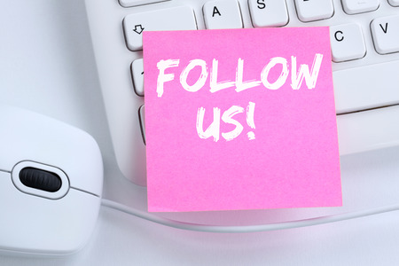 follow us: Follow us follower followers fans likes social networking media internet office computer keyboard